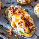 Close-up of easy twice baked potatoes on a sheet tray.