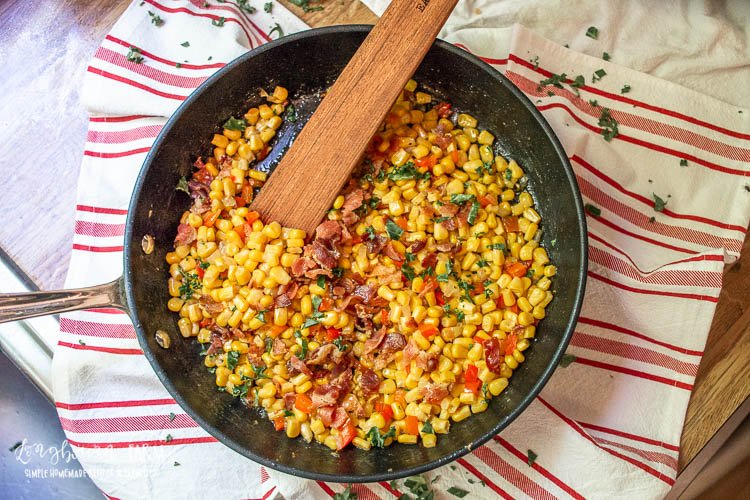 Canned corn with peppers in a pan.