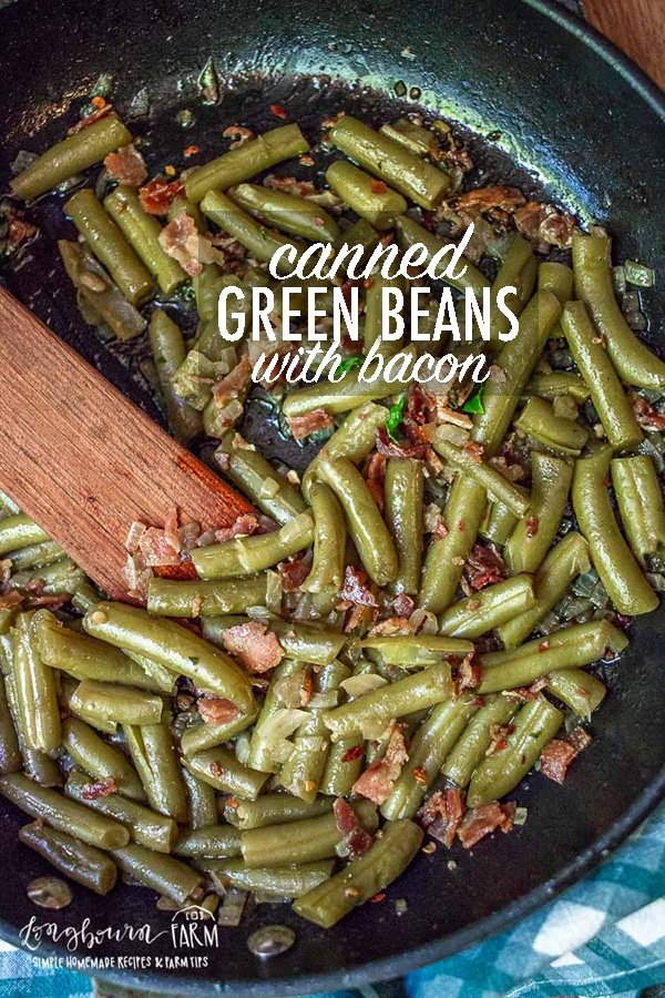 Canned green beans don't have to be boring! Add onions and bacon to kick up this pantry staple a few notches. This is a family favorite!! #greenbeans #bacon #onions #greenbeanswithbacon #cannedgreenbeans #cannedgreenbeaswithbacon #baconrecipes #sidedish #onionsandbacon #sautedveggies #sidedish