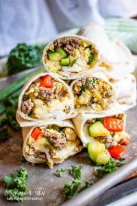 5 stacked breakfast burritos.