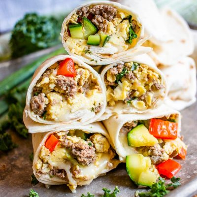 5 stacked breakfast burritos.