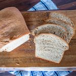 Homemade wheat bread on a cutting board.