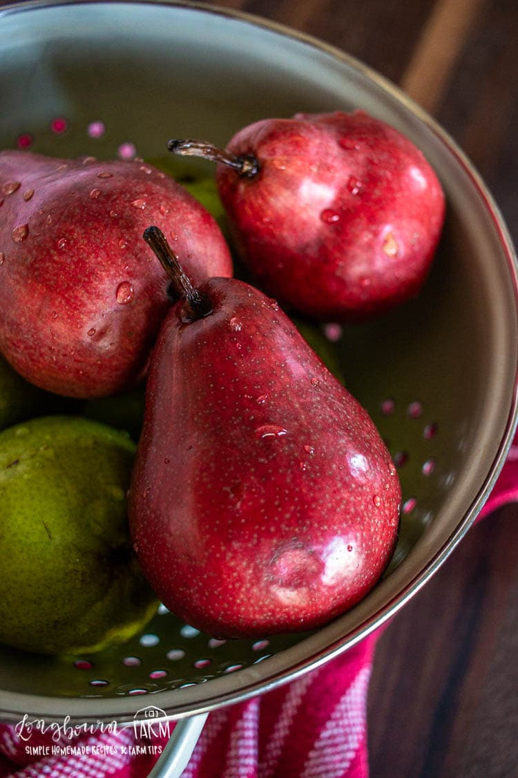 Pears in a colander.