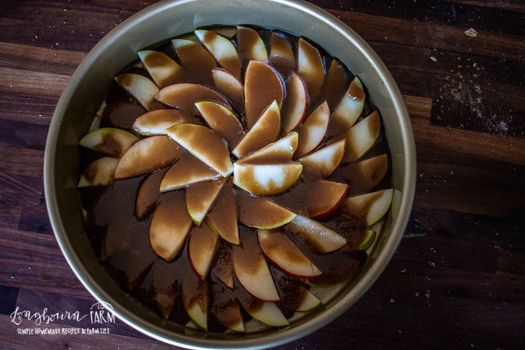 Brown sugar and butter melted together and poured over sliced pears in a cake pan