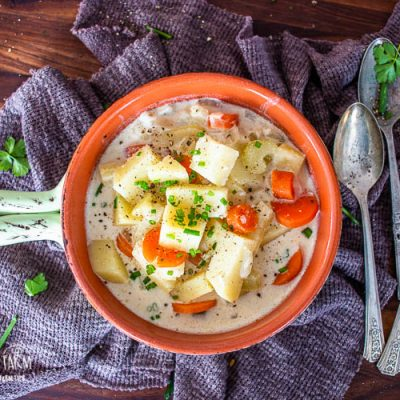 a bowl full of instant pot potato soup and 3 spoons