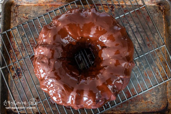 an aerial view of the ganache covered chocolate bundt cake