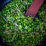 stirring the italian peas in the pan