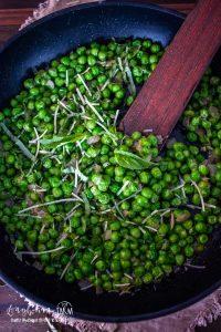 stirring the italian peas in the pan