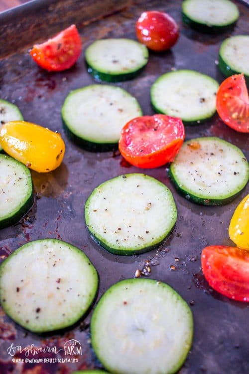 an upclose view of the oven roasted zucchini and tomatoes