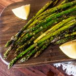 grilled asparagus on a cutting board