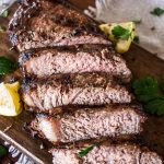 close up view of sliced grilled steak on a cutting board