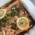 close up of lemon dill salmon in a baking dish