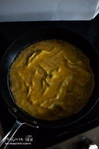 cooking omelet in skillet