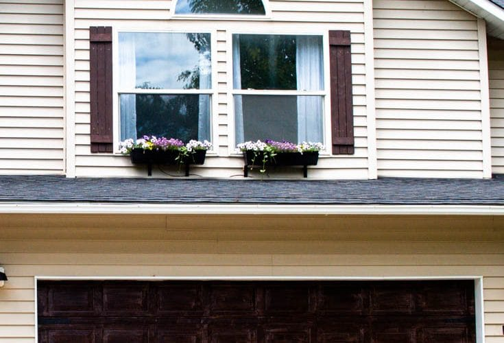 window flower boxes outside second story windows