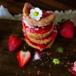 flower topped stack of strawberry cheesecake bites