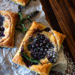 blueberry danishes with powdered sugar on top