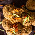 carrot and zucchini muffins garnished with shredded carrots and zucchini