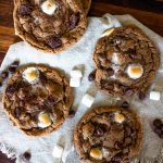 mexican hot chocolate cookies with marshmallows and chocolate chips on a piece of cloth