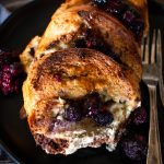 blueberry baked french toast on a plate with a fork