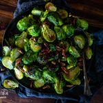 roasted brussel sprouts on a plate with a large spoon