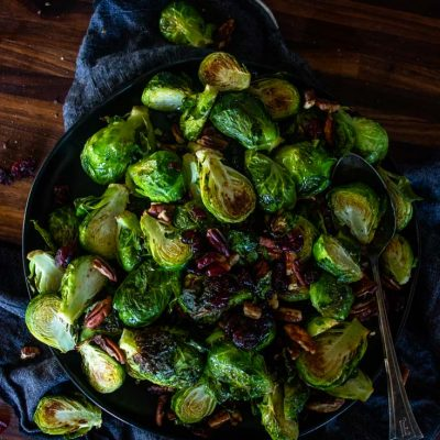 a plate filled with brussel sprouts and a spoon