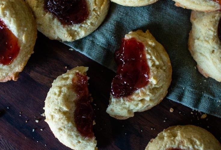 Raspberry Thumbprint Cookies are a delicious cookie that's especially fun to make. Packed with color and flavor, they are an instant hit.