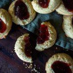 raspberry thumprint cookies with one broken in half