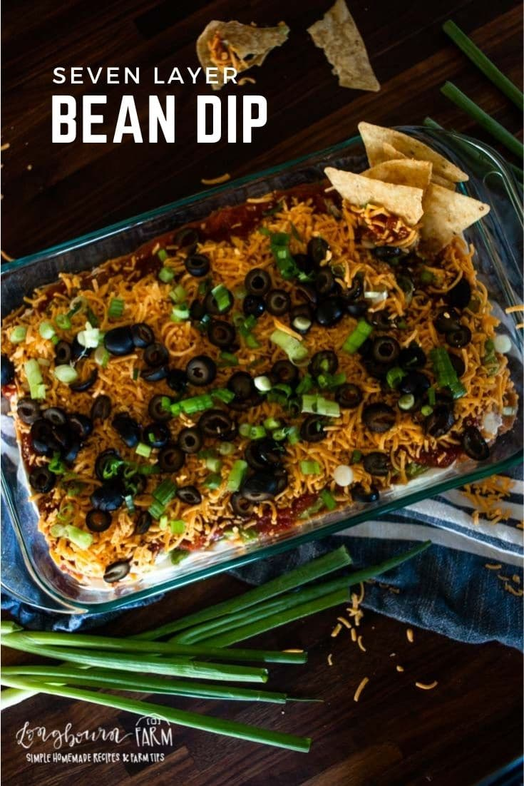 7 layer taco dip is a tasty appetizer that's perfect for tailgate parties, fiestas, or snacking and lounging around the house on the weekend.