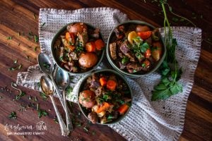 aerial view of three bowls full of irish beef stew