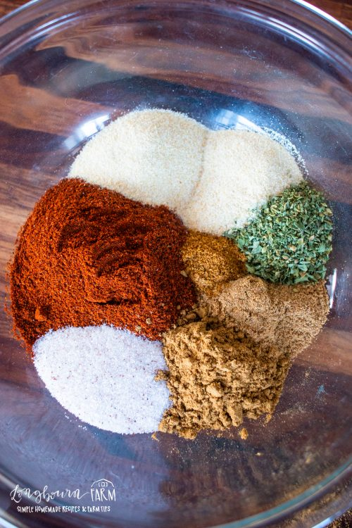 ingredients for taco seasoning in a glass bowl