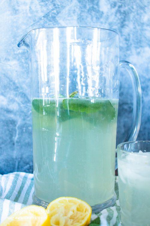 a pitcher full of mint leaf lemonade